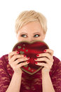 Woman with valentine s gift and funny look looking Stock Photography