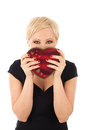 Woman with valentine s gift looking funny Stock Photography