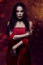 Woman vampire beautiful in red dress Stock Photography