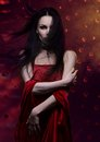 Woman vampire beautiful in red dress Royalty Free Stock Photography