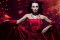 Woman vampire beautiful in red dress Royalty Free Stock Image