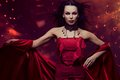 Woman vampire beautiful in red dress Royalty Free Stock Photos
