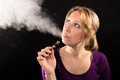 Woman vaping electronic cigarette enjoying an e cig Stock Photography