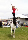 Woman vaulting performance young performs routine on horseback at the rio grande valley celtic festival in albuquerque new mexico Stock Photos