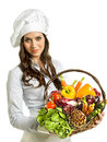 Woman with vegetables a basket full of Royalty Free Stock Images