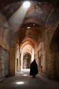 Woman in Veil Passing through Grand Old Bazaar of Yazd Royalty Free Stock Photo
