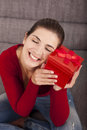 Woman very happy with the present beautiful and on sofa holding a christmas Royalty Free Stock Photo