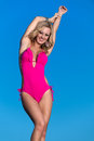 Woman very happy swimsuit against blue sky background Royalty Free Stock Image