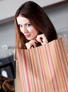 Woman is very pleased with bargains Royalty Free Stock Photos