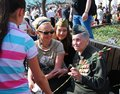 A woman veteran receives carnations from girl victory day celebration on may in moscow Stock Image