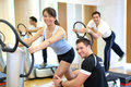 Woman on vibration plate instructed by her trainer Royalty Free Stock Photo