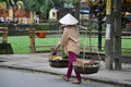 A woman vietnamese woman walks down to the market in hoian Royalty Free Stock Photography