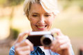 Woman viewing pictures camera happy middle aged on Royalty Free Stock Photo