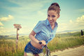Woman with vintage bike outdoor, summer time Royalty Free Stock Photo