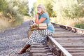 Woman with vintage luggage on railroad tracks Royalty Free Stock Photography