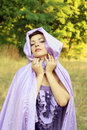 Woman in violet cloak Stock Photo