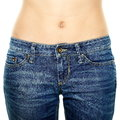 Woman waist wearing jeans weight loss stomach closeup skinny on a healthy slim fit body Royalty Free Stock Images