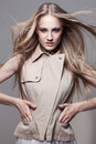 Woman in waistcoat young beautiful blond with flying hair wearing fashionable Stock Photos