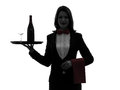 Woman waiter butler serving red wine silhouette one caucasian in on white background Stock Images