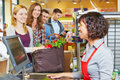 Woman waiting in line at supermarket checkout with groceries the Royalty Free Stock Image