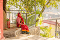 A woman waiting for someone in bindabasini temple pokhara typical nepali dress is to come nepal Stock Photography