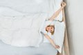 Woman Waking Up In Bed Royalty Free Stock Photo