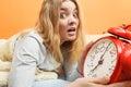 Woman waking up late turning off alarm clock. Royalty Free Stock Photo