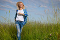 Woman walk in grass field Stock Photography