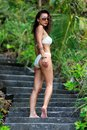 Woman walk in nature walking up stairs the tropical Royalty Free Stock Image
