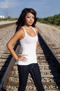 Woman walking along railway tracks Stock Image