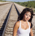 Woman walking along railway tracks Royalty Free Stock Photos
