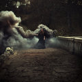 Woman walking on the bridge in heavy black smoke Royalty Free Stock Photo