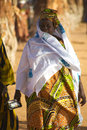 Woman walking in the busy street of mopti mali december unidentified dressed with wonderful local fabrics Stock Images