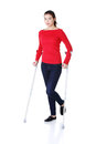 Woman walking with crutches becouse of leg injury Stock Photo