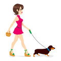 Woman Walking Dachshund Royalty Free Stock Image