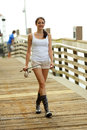 Woman walking on the dock with a fishing pole stock image of docks Royalty Free Stock Images