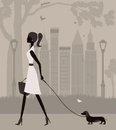 Woman walking with a dog in the park Stock Photography