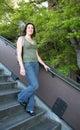 Woman walking down stairs Stock Image