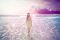 Stock Images Woman walking on dreamy beach enjoying ocean view