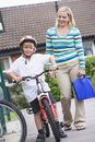 A woman walking her son home from school Royalty Free Stock Photo