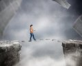 Woman walking on pages reading a book and over cliff Stock Images