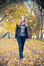 Woman walking in a park. Royalty Free Stock Images