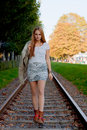 Woman walking on rail track model with leather jacket Royalty Free Stock Image