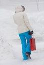 Woman Walking In The Winter City