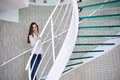 Woman walking on spiral stairs Royalty Free Stock Photo