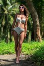 Woman walking in tropical nature slim beautiful Royalty Free Stock Photos