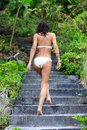 Woman walking up stairs in the tropical nature Royalty Free Stock Images