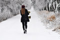 Woman walking in winter forest Royalty Free Stock Photo