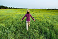 Woman walks in field Royalty Free Stock Photo