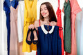 Woman in wardrobe young happy trying on new blue dress and shoes to wear the Royalty Free Stock Photo